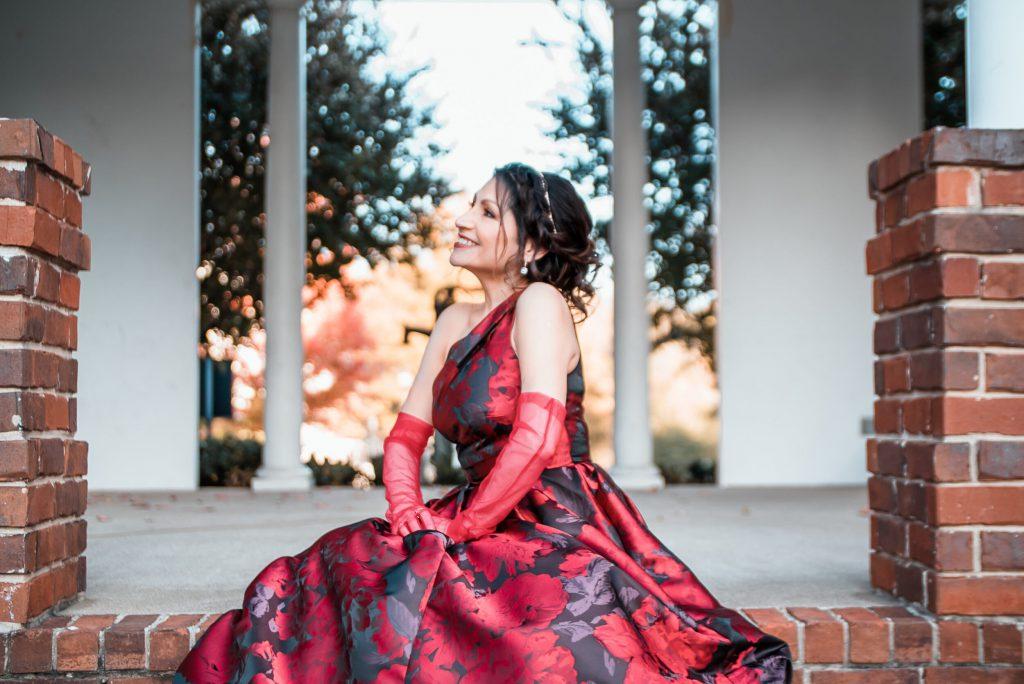 Monica Ortiz smiling in red dress