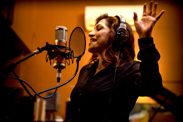 Monica singing in the recording booth
